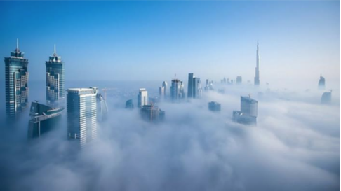 image of large buildings above clouds in Dubai