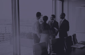 image of four people in a meeting