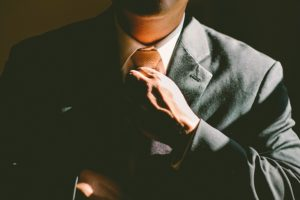 image of a professional adjusting his tie